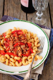 Cellentani Pasta with Minced Beef, Tomato and Caps Stock Image