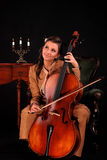 Cellist. Young attractive girl with a cello stock photo