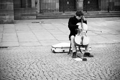 Cellist alone in place Royalty Free Stock Photos