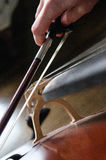Cellist and bow. A close up of a bow of a cellist on a cello stock photo