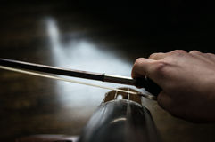 Cellist and bow. A close up of a bow of a cellist on a cello stock photos