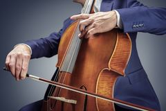 Cellist or cello player performing royalty free stock image