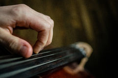 Cellist. A close up of the hand of a cellist on the cello stock image