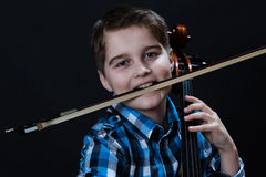 Cellist with fiddlestick. Young boy Cellist playing with fiddlesticks and cello royalty free stock image