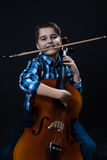 Cellist with fiddlestick. Young boy Cellist playing with fiddlesticks and cello royalty free stock photo
