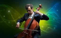 Cellist met kleurrijk legendarisch concept stock foto's