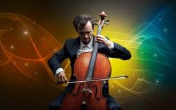 Cellist met kleurrijk legendarisch concept stock fotografie