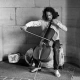 Cellist in Paris. PARIS - France - 8 July 2012 - cellist in Paris royalty free stock photo