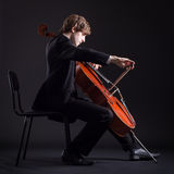Cellist playing on cello Royalty Free Stock Image