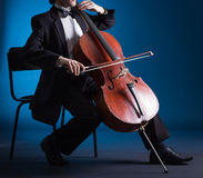 Cellist playing on cello stock photos