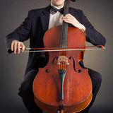 Cellist playing on cello stock image