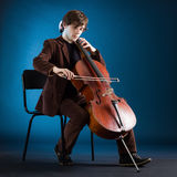 Cellist playing on cello stock photography
