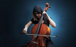 Cellist playing on instrument with empathy royalty free stock photos