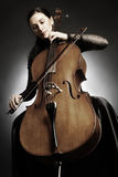 Cellist playing violoncello Stock Images