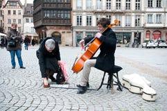 Cellist in the street. STRASBOURG - France - 12 February 2016 - cellist in the street stock image