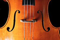 Cello. An old, antique Cello isolated on a black background Royalty Free Stock Image