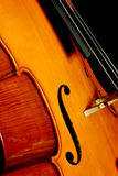 Cello. Close Up of a cello isolated on black backround royalty free stock images