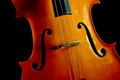 Cello. Close Up of a cello isolated on black backround stock photos