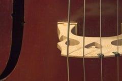 Cello Bridge. A violoncello bridge close up Royalty Free Stock Images