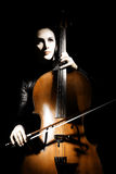 Cello classical. Musician cellist performer. Woman with musical instrument on black background Stock Photo