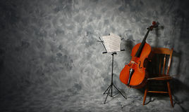 Cello concert. Cello and music stand Stock Photos