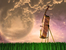 Cello in landscape Royalty Free Stock Images
