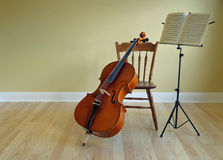 Cello and music stand Royalty Free Stock Images