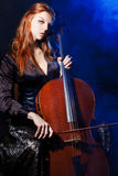 Cello musician, Mystical music Royalty Free Stock Images