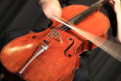 Cello. Musician playing a cello at a classical music concert stock photography
