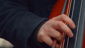 Cello Musician Playing in the Street Close-up stock footage