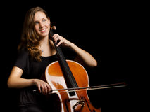 Cello player. Portrait of young woman cello player stock image