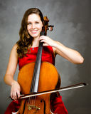 Cello player. Portrait of young woman cello player Royalty Free Stock Photos