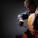 Cello player or cellist performing. In an orchestra with copy space royalty free stock images