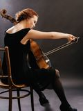 Cello player enjoying her music Stock Images