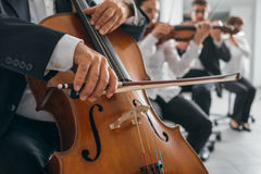 Cello player's hands close up Royalty Free Stock Images