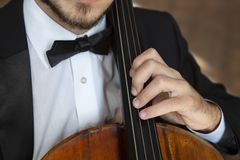 Cello playing cellist hands close up orchestra instruments stock photos
