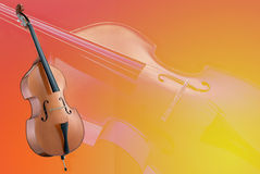 Cello on a red and yellow faded  background Royalty Free Stock Photos