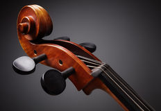 Cello scroll. On headstock and tuning pegs Royalty Free Stock Image
