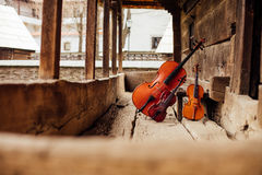 Cello and violin leaning on a porch Stock Photography