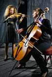 Cello and violin  musicians Royalty Free Stock Photography