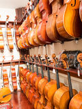 Cello, Violin & Viola Instruments On Display. Old world master craftsmanship on display for purchase featuring musical string instruments; cielo, bass, violin & Stock Photo