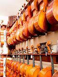 Cello, Violin & Viola Instruments On Display. Old world master craftsmanship on display for purchase featuring musical string instruments; cielo, bass Stock Photos