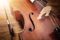 Cello on wood background Royalty Free Stock Photos