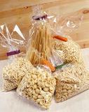 Cellophane bags containing different pastas Royalty Free Stock Photography