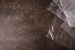 Cellophane bags on a dark marble background. Polute the nature. Eco concept Royalty Free Stock Photos