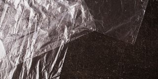 Cellophane bags on a dark marble background. Polute the nature. Eco concept Stock Photo