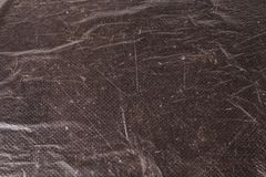Cellophane bags on a dark marble background. Polute the nature. Eco concept Royalty Free Stock Images