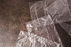 Cellophane bags on a dark marble background. Polute the nature. Eco concept Royalty Free Stock Image