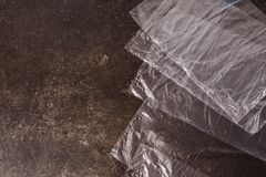 Cellophane bags on a dark marble background. Polute the nature. Eco concept Royalty Free Stock Photo