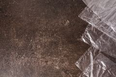 Cellophane bags on a dark marble background. Polute the nature. Eco concept Stock Images